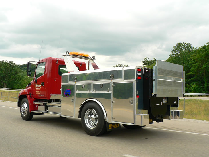 aluminum mechanical service body cruising down highway