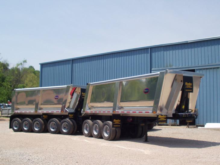 Rage aluminum end dump trailers as a Michigan train