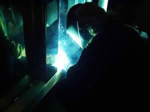 Welder fabricating an aluminum trailer